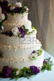 Purple And White Wedding Wedding Cake With Purple And Lights In The Background Stock Photo