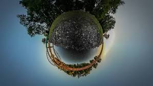 tiny planet is running toward railroad bridge spherical