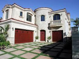 front of home with arched door u0026 barn door in huntington beach ca