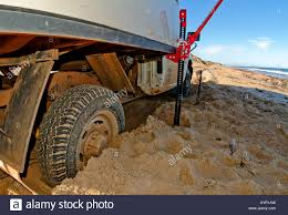offroad camper off road camper rv jacked up and stuck in the sand western