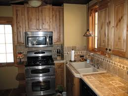 decorating oak medallion cabinetry with under cabinet microwave