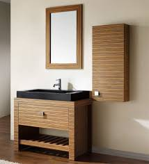 interesting large black vessel sink on funky bathroom vanity feat