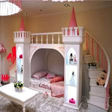 luxury kids bedroom with large castle bed with stair and slide