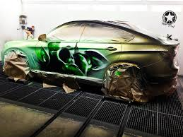 bmw x6 lexus bmw x6 paintjob reveals inner hulk when you pour water on it