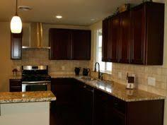 Santa Cecilia Backsplash Ideas by Ryan Homes Cherry Bordeaux Cabinets And Santa Cecilia Granite