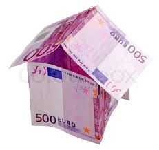 euro house made from 50 euro bill with euro coins isolated on