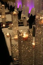 Centerpieces With Candles For Wedding Receptions by Glitter Covered Floating Candles For Wedding Centerpieces
