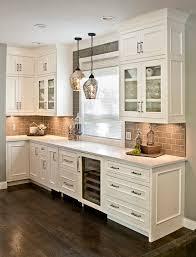 White Cabinets With Grey Quartz Countertops Grey Cabinets Gray Cabinetry Painted Kitchen Cabinets Beverage