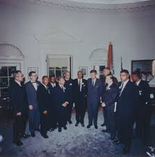 a photograph of civil rights leaders meeting with president