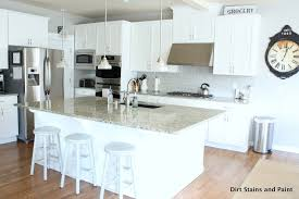 grey subway tile in a white kitchen