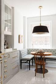 blue kitchen banquette light wood flooring bulb pendant lighting