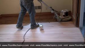 refinishing hardwood floors applying stain with buffer