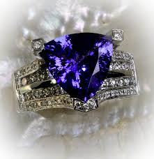 tanzanite rings from images Trillion cut tanzanite ring in a micro pave diamond bridge setting jpeg