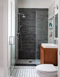 narrow small bathroom with mirror creating a luxury small