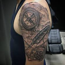 compass tattoo under breast 54 feather tattoo design ideas with meanings 2018