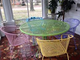 spray painted wrought iron patio furniture using rustoleum satin paint