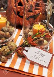 happy halloween tag message with orange candles and nuts