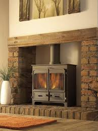 this is what i want but with tv above and rustic matching shelves to each side wood stove