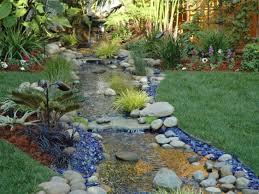 backyard stream with blue landscape glass bourget bros