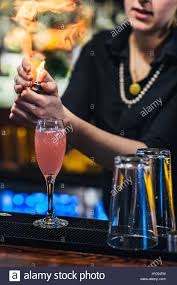 french martini waitress flaming an orange peel while making a french martini