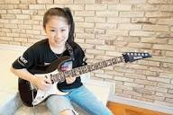 guitargirlmag.com/wp-content/uploads/2018/12/Li-sa...