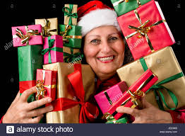 what to get an elderly woman for christmas cheerful elderly woman with santa claus hat is embosoming a host