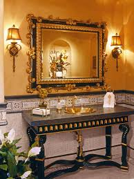 elegant black and gold bathroom a large mirror with a marble and