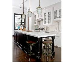 white kitchen with black island black and white kitchen inspiration blue dish