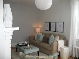 standing lamp white modern sofa flower vase wooden table candle