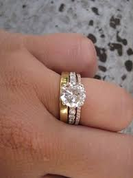 a mix of a white gold engagement ring and a yellow and diamond