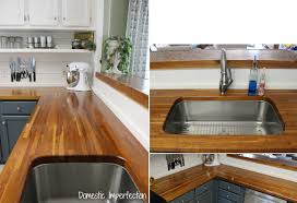 Undermount Sink In Butcher Block Countertop by Countertops White Cabinet With Open Shelves White Subway Tile