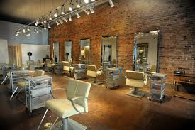 exposed brick wall lighting the new river north salon which features exposed brick walls and