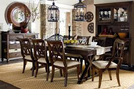 small formal dining room yellow light copper chandelier brown