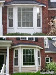 regaling exterior home design with brick wall wallside windows