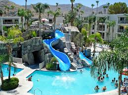 family pool with waterslides at the palm resort in palm