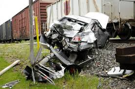 driver suffers minor injuries in crash with train local news