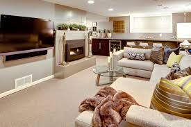 modern basement remodeling idea with beige sectional sofa and
