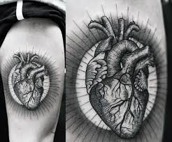 90 anatomical heart tattoo designs for men blood pumping ink