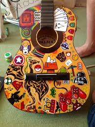 sharpie art on an old broken guitar i found in the trash one