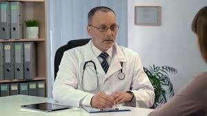 Hospital Receptionist Doctor Filling In Patient U0027s Registration Form Medical