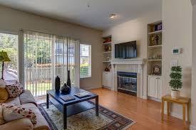 family room with hardwood floors metal fireplace in bellevue wa
