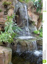 nice indoor garden with waterfall design stock photo image 64676262