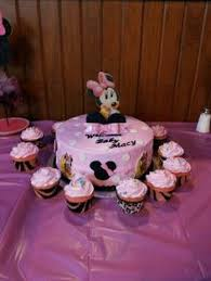 diaper cake surrounded by cupcakes with