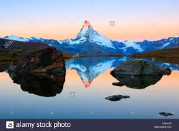 view from a mountain lake at the matterhorn with the top in