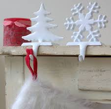 decorating white christmas stocking hanger in snowflake and tree