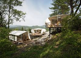 south korean luxury campsite features cabins and tents on stilts