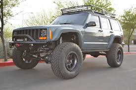jeep cherokee lights don t mind this roof rack and light bar combo jeeps pinterest