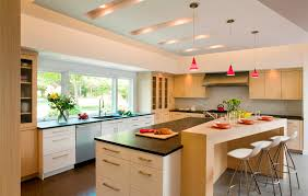lovely red funnel glass pendant lights over white kitchen island