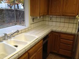 granite countertop white wood grain kitchen cabinets 4 burner