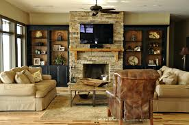 built in entertainment centers with fireplace bookcases around